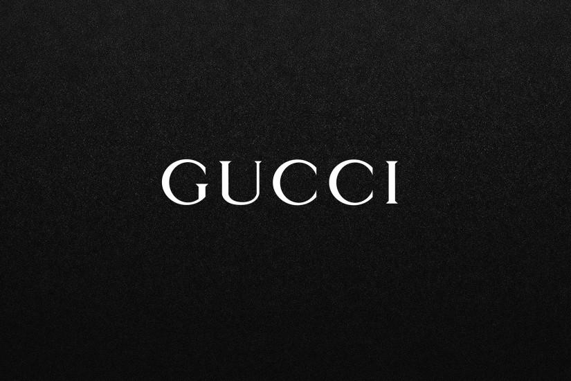 Gucci White Logo on Black Background.