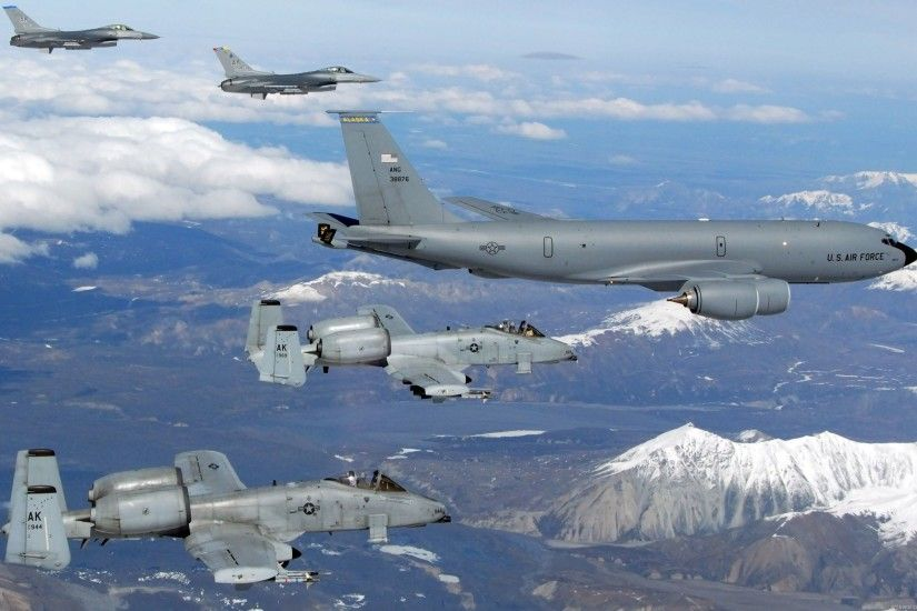 A USAF Boeing Stratotanker refuels some Falcons and some Warthogs.
