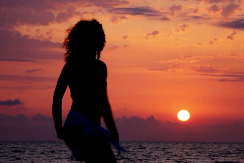 silhouette of young dancing woman on beach, sunset sea and sky in background  Stock Video Footage - VideoBlocks