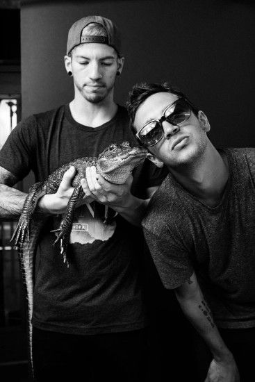 Josh Dun and Tyler Joseph of Twenty One Pilots with Fred the gator