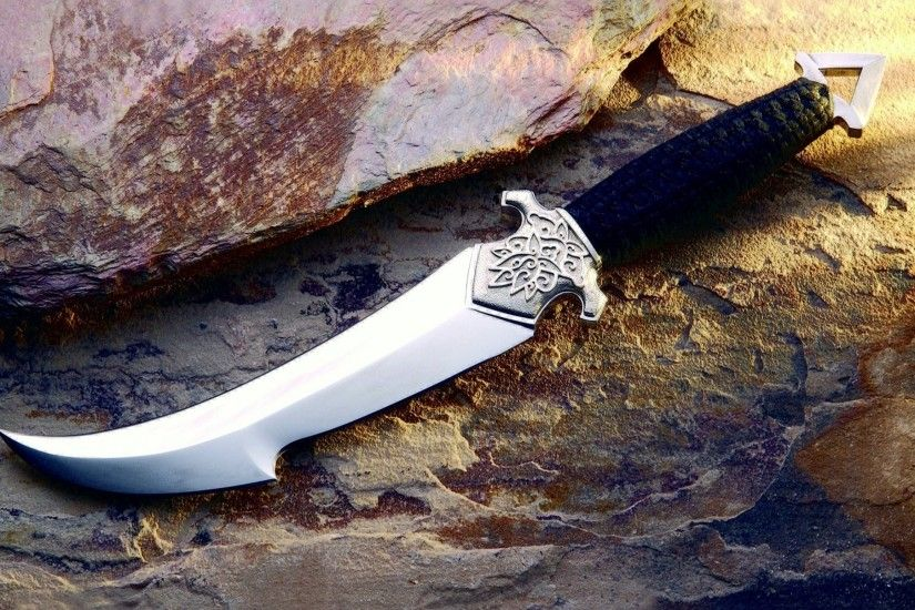 dagger engraving leather rock stone weapon