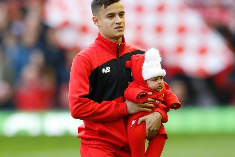 Philippe Coutinho holding his daughter at Anfield