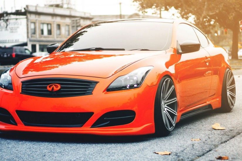 Orange Infiniti G37 coupe on the road wallpaper