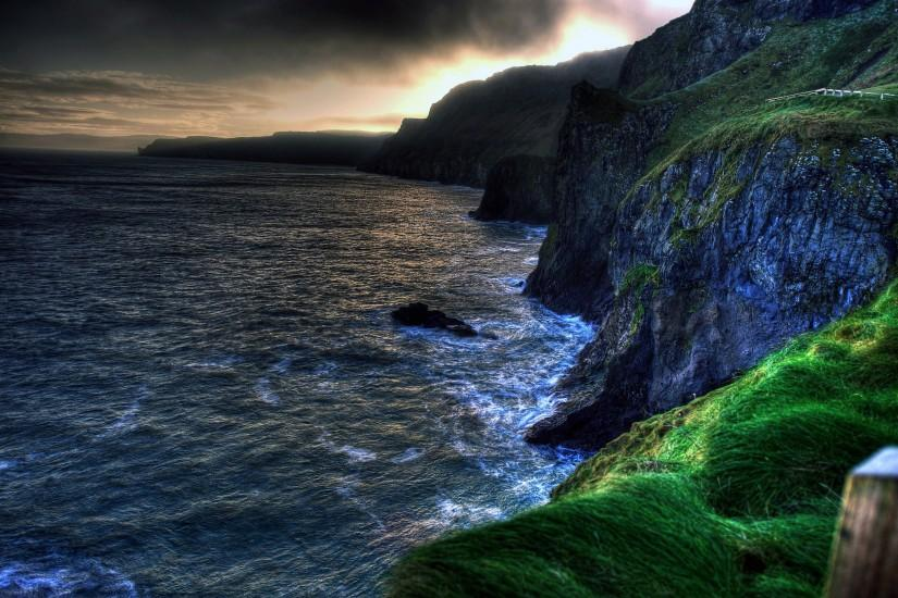 The wallpaper of amazing coastline of Ballintoy in Northern Ireland .
