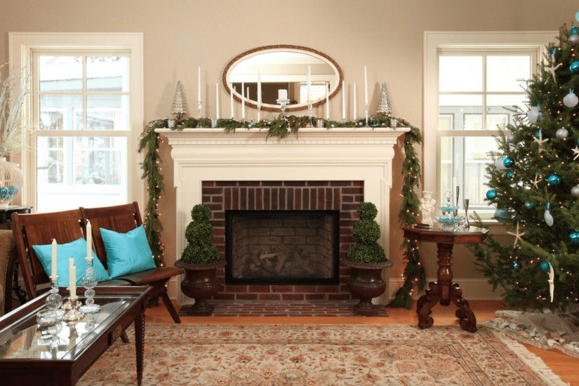 Small Fireplace Wall Added Near An Oval Mirror On Grey Wall Background Also  Christmas Tree On