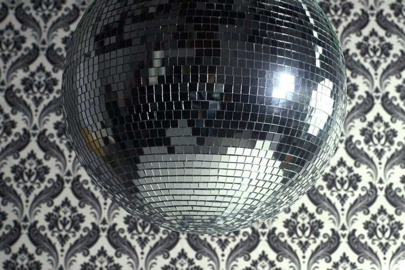 a funky discoball spinning with retro wallpaper background. perfect clip  for club visuals or party/celebration Stock Video Footage - VideoBlocks