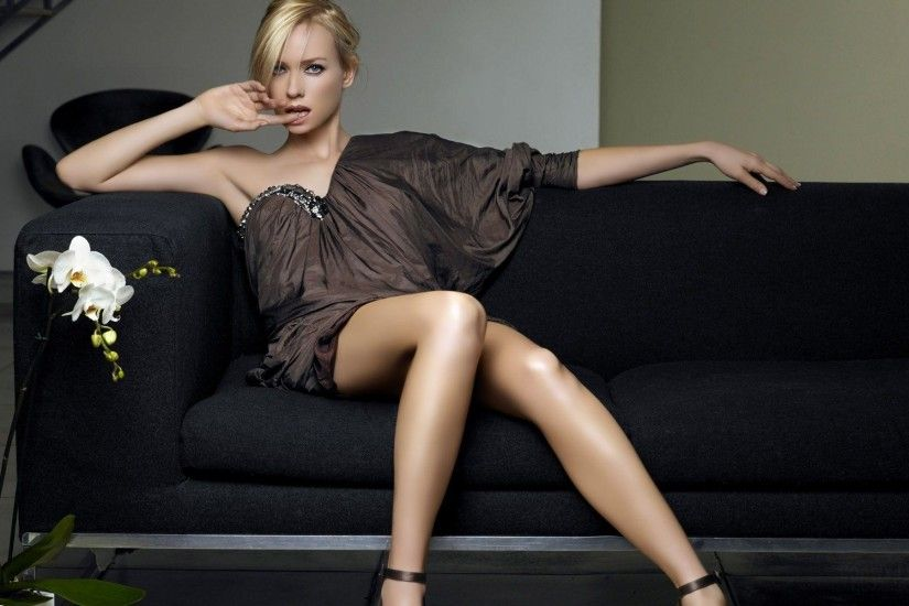 Naomi Watts sitting on the couch
