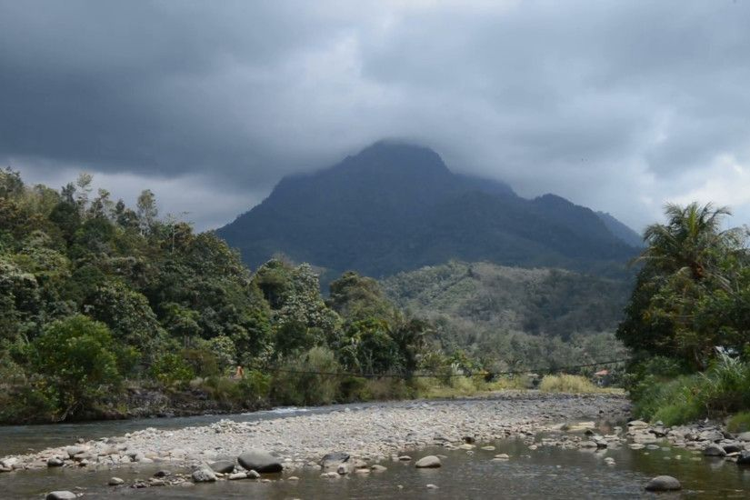 Subscription Library Beautiful shallow river with mountain background on  cloudy day. Idyllic Nature Holiday Scene. Zoom