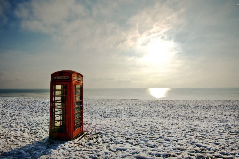Red telephone booth on a winter beach wallpaper 2560x1600 jpg