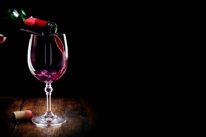 glass wine red a bottle plug black background