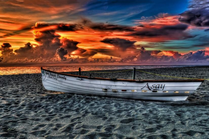 Rowboat beach sunset Wallpapers Pictures Photos Images. Â«