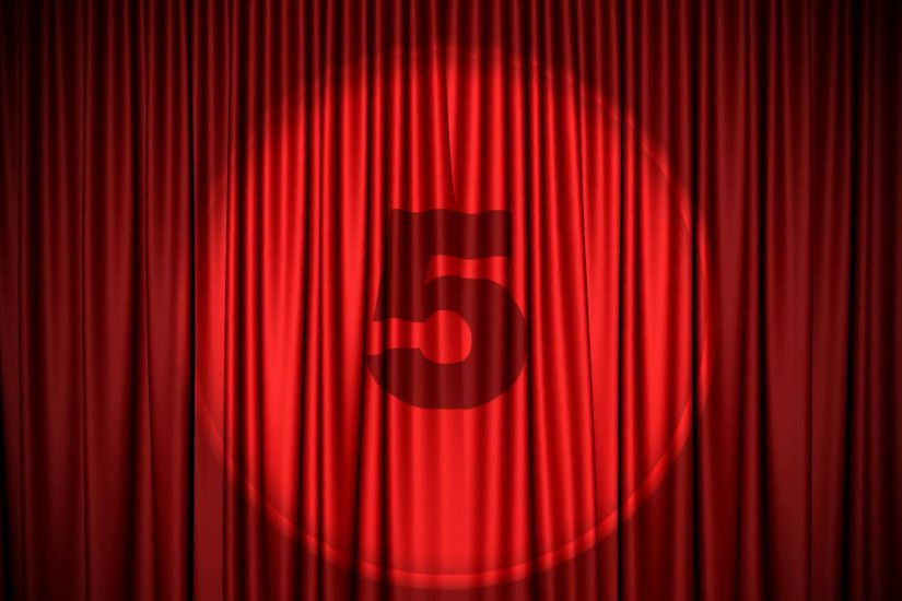Subscription Library Red Cinema/theater type curtain with numbers 5  counting down to one projected on it