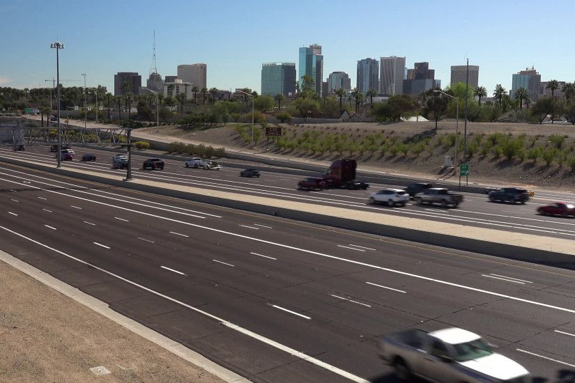 I-10 freeway timelapse of traffic with downtown Phoenix, Arizona in the  background Stock Video Footage - VideoBlocks