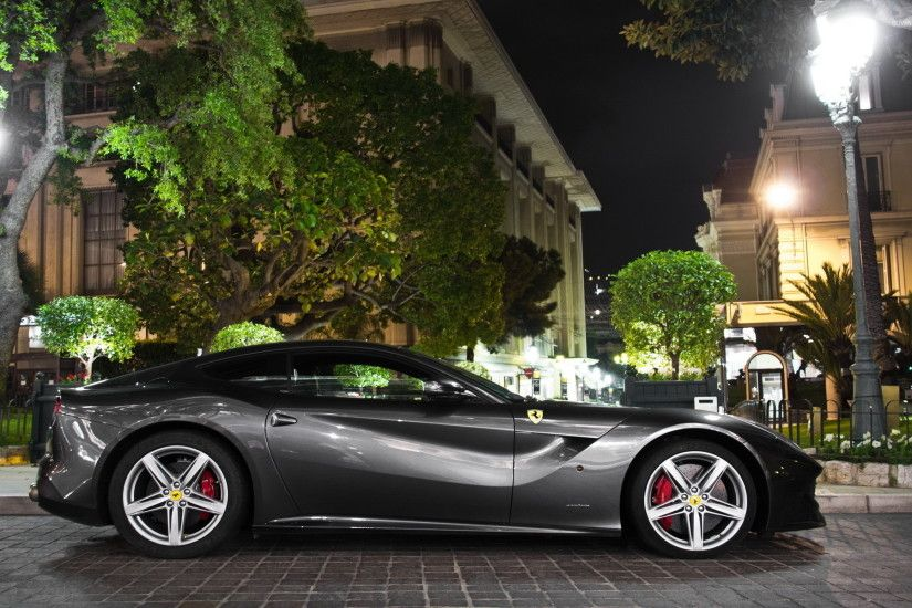 Side view of a black Ferrari F12 Berlinetta wallpaper 1920x1200 jpg