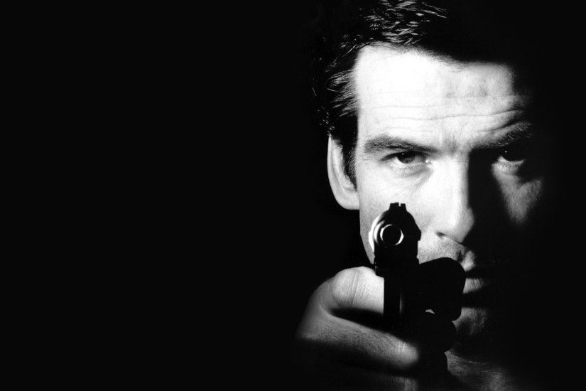 pierce brosnan pierce brosnan gun james bond james bond black background