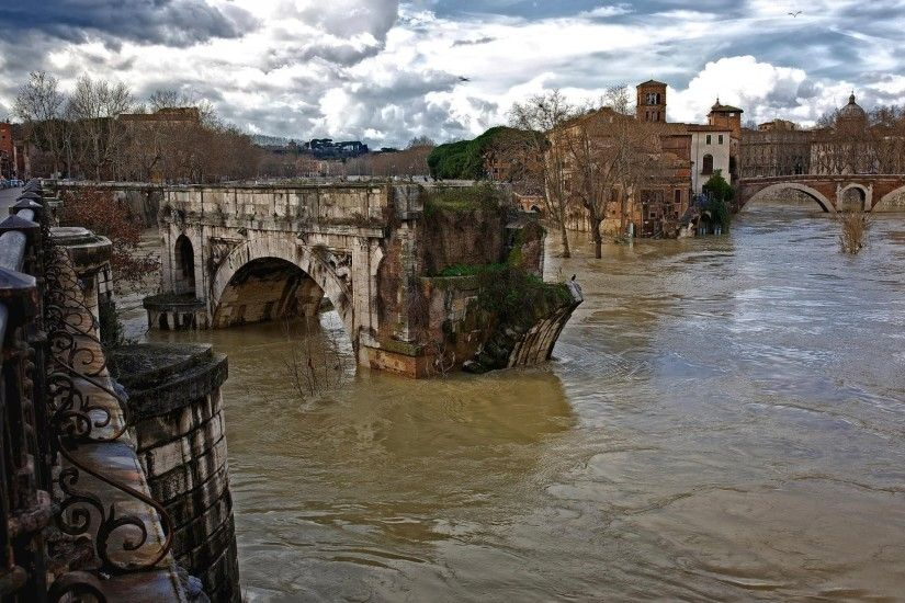 rome italy water flows ruins the old ancient roman bridge tiber