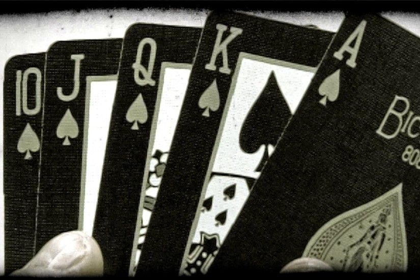 A royal flush of spades folded out from behind an ace. Vintage stylized  video clip.