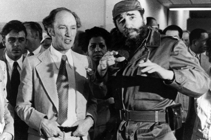 Prime Minister Pierre Trudeau looks on as Cuban President Fidel Castro  gestures during a visit in