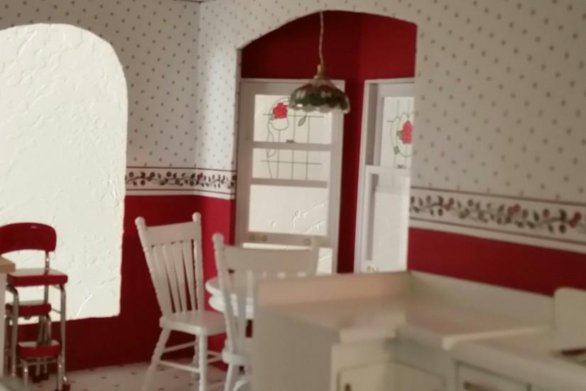 Kitchen with wallpaper ...