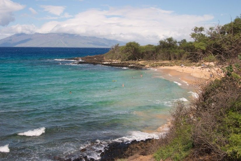 small beach with view of western Maui in the distance