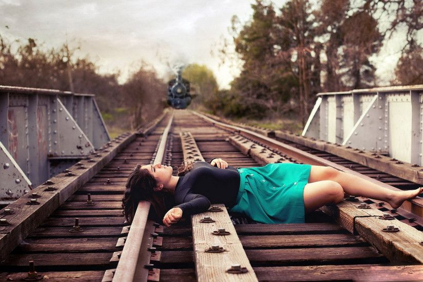 Sad Girl Lying on Railway Tr