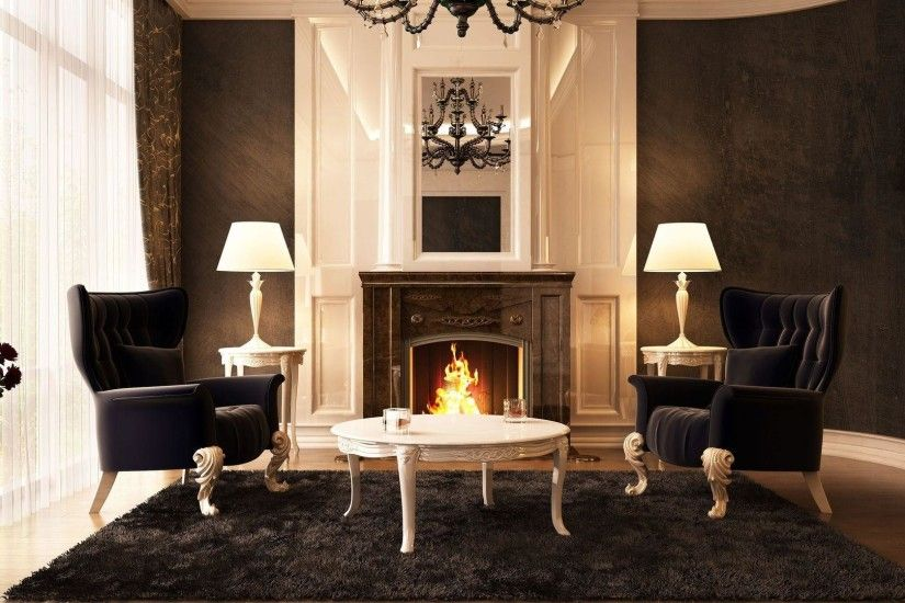 Black chairs in front of the fireplace