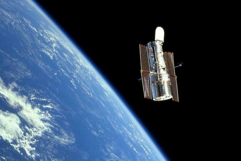 Hubble Space Telescope and the Earth wallpaper