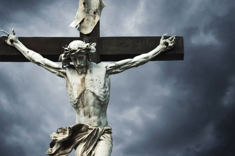 Crucifixion. Christian cross with Jesus Christ statue over stormy clouds  time lapse. 1920x1080, 1080p, hd format Stock Video Footage - VideoBlocks