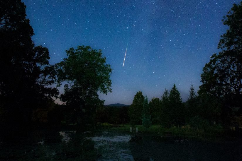 A meteor from the Perseid meteor shower is seen zipping through the sky in  Hungary in
