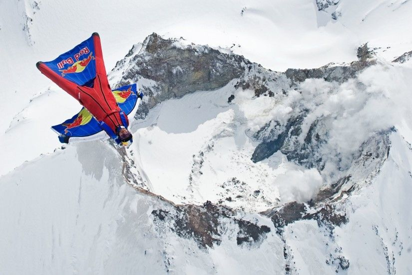 wingsuit pilot fly pilot volcano mountain smoke snow winter trailers  parachute red bull extreme sports