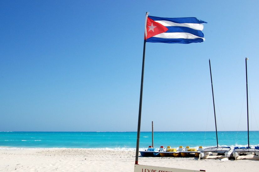Flag of Cuba on the beach in the resort of Cayo Largo, Cuba