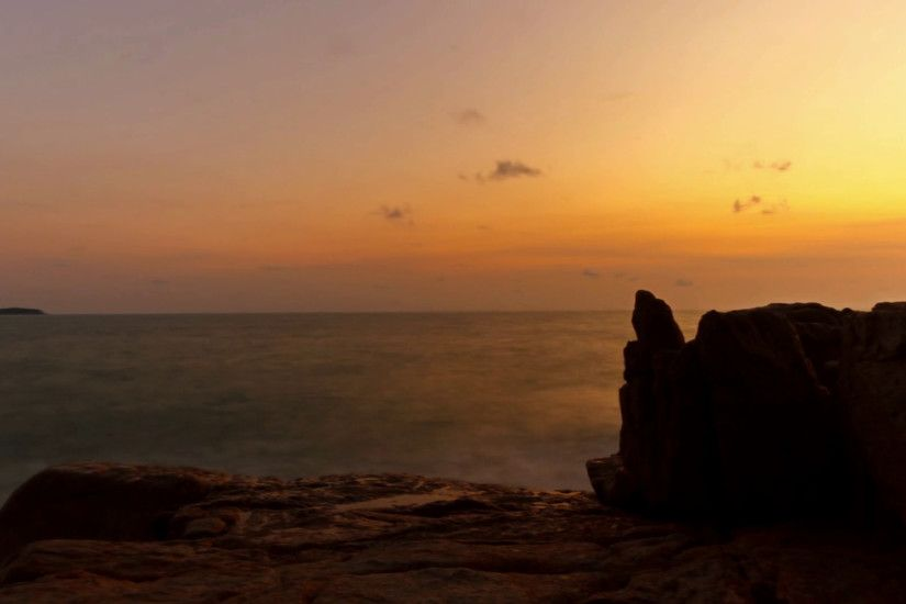 Young woman meditating on the rocks by the sea on sunrise background Stock  Video Footage - VideoBlocks
