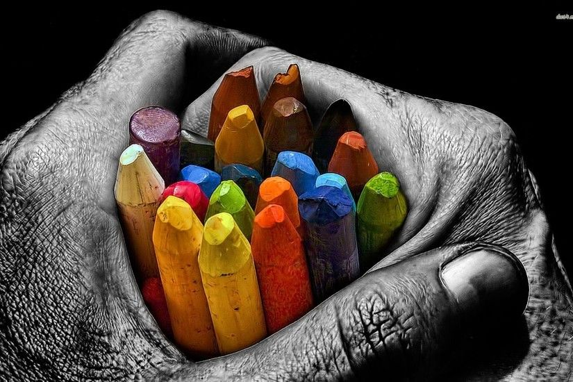 Colorful Crayons In Hand