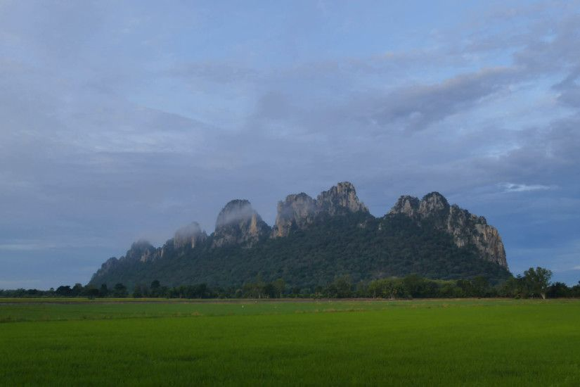 Landscape of a green field rice with mountain background, Thailand. Time  lapse Stock Video Footage - VideoBlocks