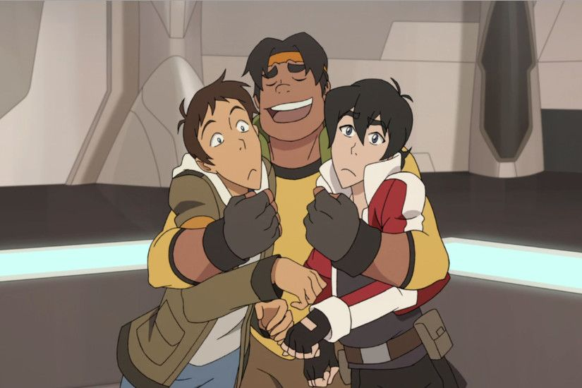 Hunk gives Lance and Keith a tight and loving hug from Voltron .
