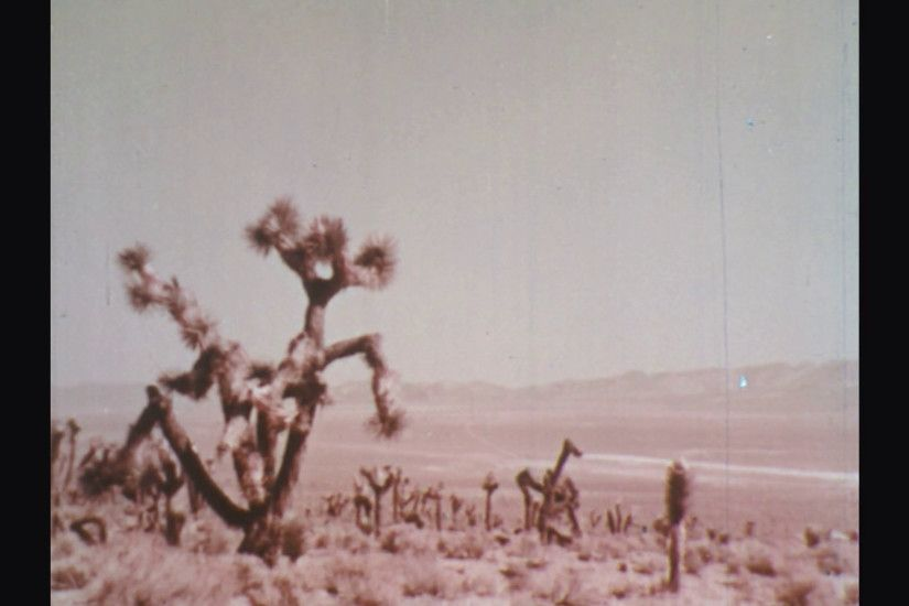 UNITED STATES: 1960s: nuclear explosion in desert. Mushroom cloud in sky.  Stock Video Footage - VideoBlocks
