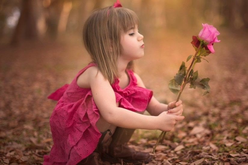 Cute Baby Girl With Roses HD Backgrounds.
