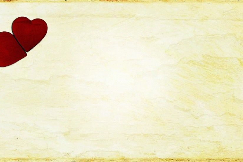 two red hearts on a vintage background