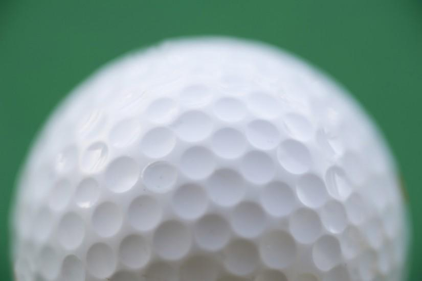 a golf ball on a green background