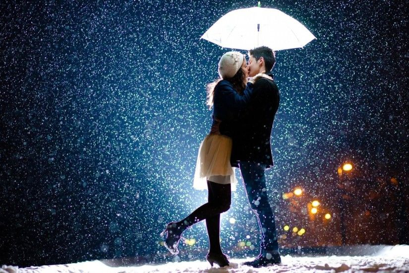 Cute couple kissing on a winter night