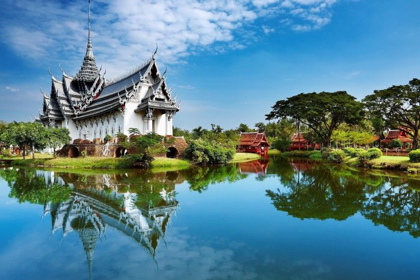 Historic Thai temple off a lake #thailand #culture #travel