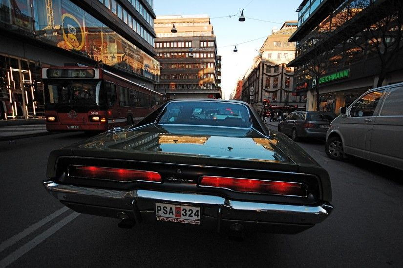 Car Dodge Charger RT 1969 on a city street
