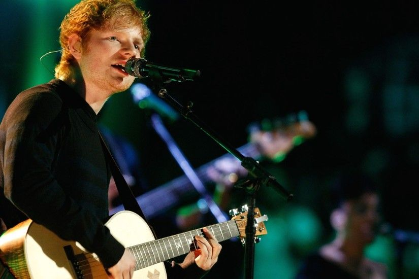 Ed Sheeran Wallpaper, Ed Sheeran is singing and playing the guitar on the  stage.
