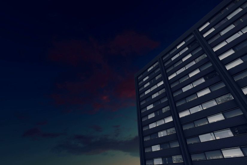 Rotating video of abstract high rise office buildings with lighted windows  against night sky background. Low angle view. Realistic 3D animation.