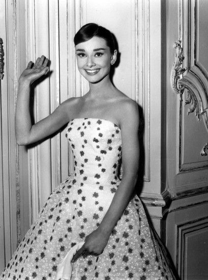 Audrey Hepburn is stunning in this sweet floral, flared skirted, strapless  gown.