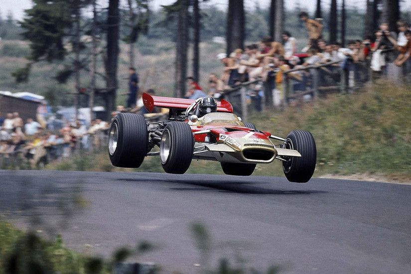 Desktop Wallpaper: Graham Hill Flying The Lotus 49