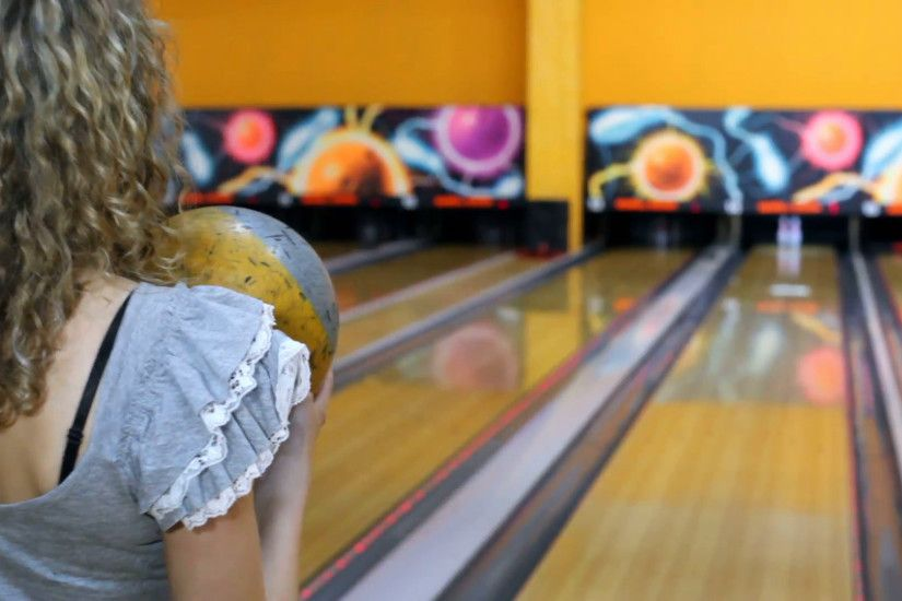 Girl throws bowling ball to beat skittles, and then jumps Stock Video  Footage - VideoBlocks