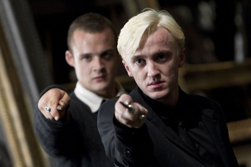 Tom Felton, right, as Draco Malfoy in Harry Potter and the Deathly Hallows —