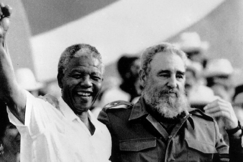 Cuban President Fidel Castro, right, and African leader Nelson Mandela  gesture during the celebration
