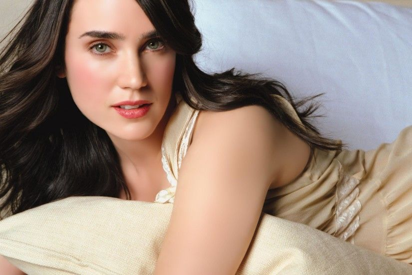 People 2560x1600 Jennifer Connelly actress brunette green eyes pink  lipstick dress lying down pillow